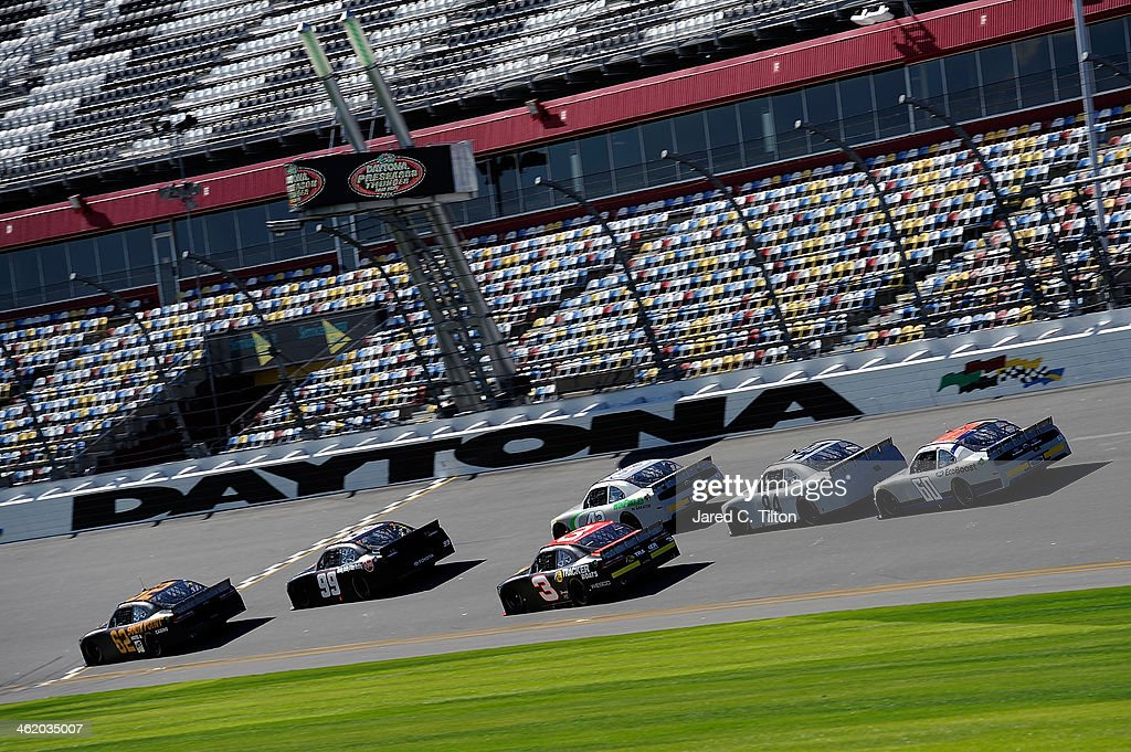 Brendan Gaughan, driver of the #62 South Point Hotel & Casino Chevrolet, leads a pack of cars during NASCAR Preseason Thunder at Daytona International Speedway on January 12, 2014 in Daytona Beach, Florida.