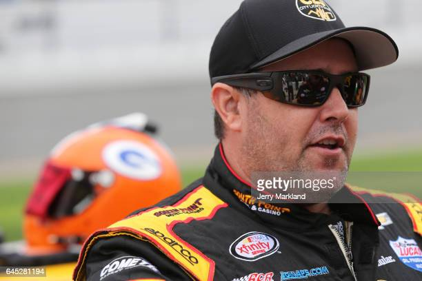 Brendan Gaughan driver of the South Point Hotel Casino Chevrolet stands on the grid during qualifying for the NASCAR XFINITY Series PowerShares QQQ...