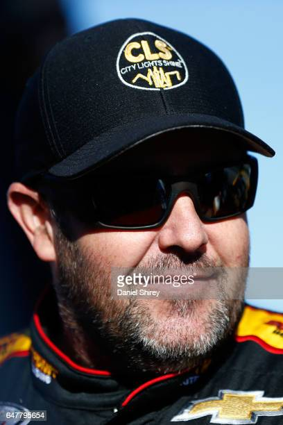 Brendan Gaughan driver of the South Point Hotel Casino Chevrolet stands on the grid during qualifying for the NASCAR XFINITY Series Rinnai 250...