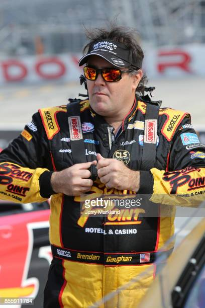 Brendan Gaughan driver of the South Point Hotel Casino Chevrolet walks on the grid during qualifying for the NASCAR XFINITY Series 'Use Your Melon...