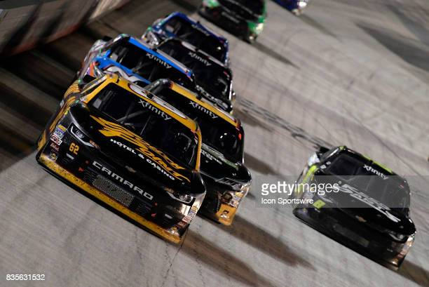 Brendan Gaughan Richard Childress Racing Chevrolet Camaro leads a pack of cars down the front stretch during the Food City 300 on August 18 at the...