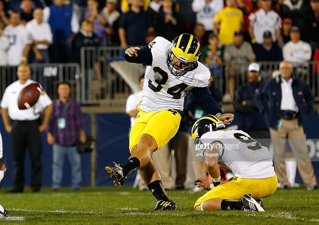 Brendan Gibbons #34 of the Michigan Wolverines kicks the winning field goal against the Connecticut Huskies in the 4th quarter against the Connecticut Huskies at Rentschler Field on September 21, 2013 in East Hartford, Connecticut.