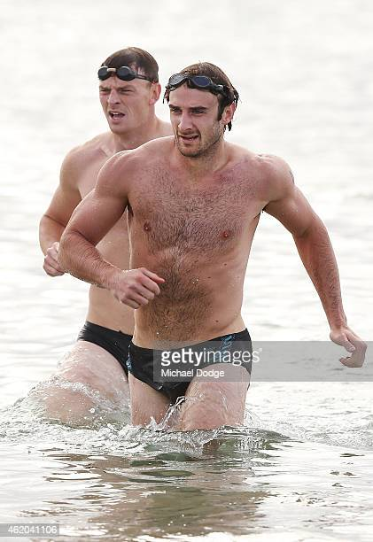 Brendan Goddard and Jobe Watson run out of the water during an Essendon Bombers AFL mini triathlon training session at Williamstown Beach on January...
