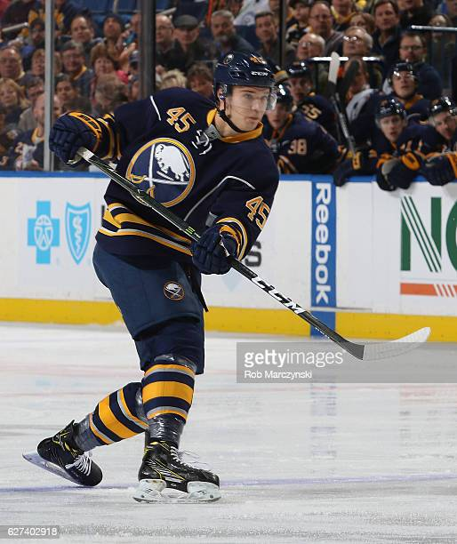 Brendan Guhle of the Buffalo Sabres playing in his first NHL game fires a first period shot against the Boston Bruins at the KeyBank Center on...