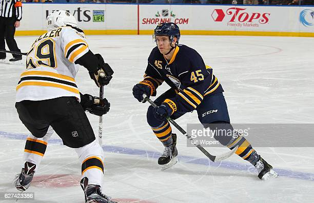 Brendan Guhle of the Buffalo Sabres skates in his first NHL game defending against Tim Schaller of the Boston Bruins at the KeyBank Center on...