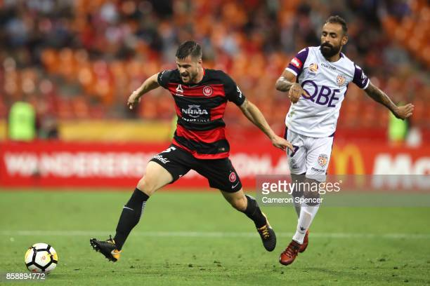 Brendan Hamill of the Wanderers and Diego Castro of the Glory contest the ball during the round one ALeague match between the Western Sydney...