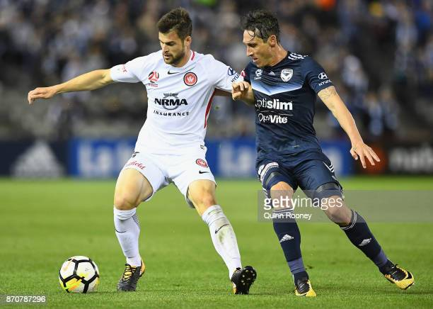 Brendan Hamill of the Wanderers and Mark Milligan of the Victory compete for the ball during the round five ALeague match between the Melbourne...