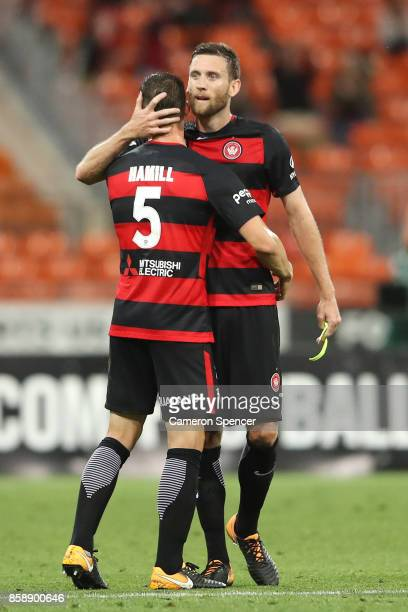 Brendan Hamill of the Wanderers and Robert Cornthwaite of the Wanderers embrace after winning the round one ALeague match between the Western Sydney...