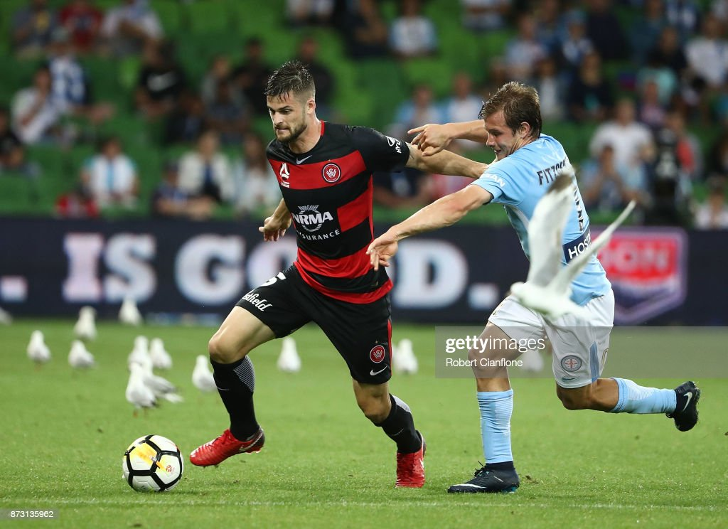 Brendan Hamill of the Wanderers is challenged by by Nick Fitzgerald of the City during the round six A-League match between Melbourne City and the Western Sydney Wanderers at AAMI Park on November 12, 2017 in Melbourne, Australia.