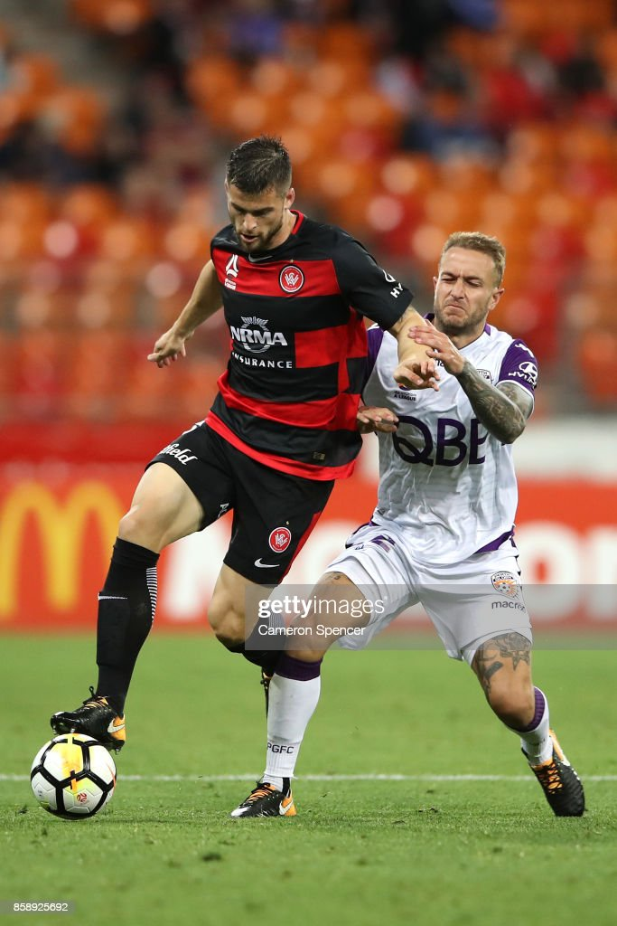 Brendan Hamill of the Wanderers is tackled by Adam Taggart of the Glory during the round one A-League match between the Western Sydney Wanderers and the Perth Glory at Spotless Stadium on October 8, 2017 in Sydney, Australia.