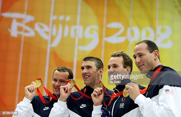 Brendan Hansen Michael Phelps Aaron Piersol and Jason Lezak of the United States hold their gold medals in the Men's 4x100 Medley Relay at the...