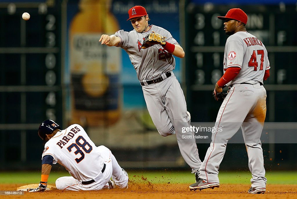 <a gi-track='captionPersonalityLinkClicked' href=/galleries/search?phrase=Brendan+Harris&family=editorial&specificpeople=534816 ng-click='$event.stopPropagation()'>Brendan Harris</a> #20 of the Los Angeles Angels of Anaheim makes a force out at second base on Jimmy Paredes #38 of the Houston Astros in the seventh inning at Minute Maid Park on May 9, 2013 in Houston, Texas.