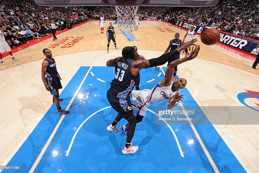 <a gi-track='captionPersonalityLinkClicked' href=/galleries/search?phrase=Brendan+Haywood&family=editorial&specificpeople=202010 ng-click='$event.stopPropagation()'>Brendan Haywood</a> #33 of the Charlotte Bobcats blocks the shot of <a gi-track='captionPersonalityLinkClicked' href=/galleries/search?phrase=Grant+Hill+-+Basketball+Player&family=editorial&specificpeople=201658 ng-click='$event.stopPropagation()'>Grant Hill</a> #33 of the Los Angeles Clippers at Staples Center on February 26, 2013 in Los Angeles, California.