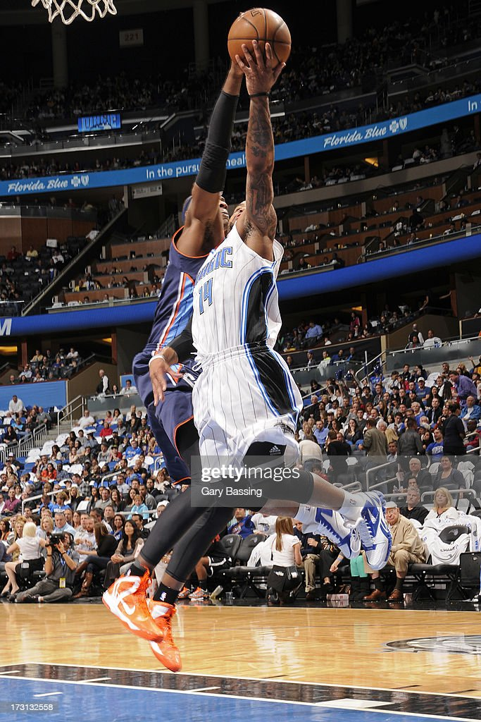 Brendan Haywood #33 of the Charlotte Bobcats blocks the shot of Jameer Nelson #14 of the Orlando Magic during a game on January 18, 2013 at Amway Center in Orlando, Florida.