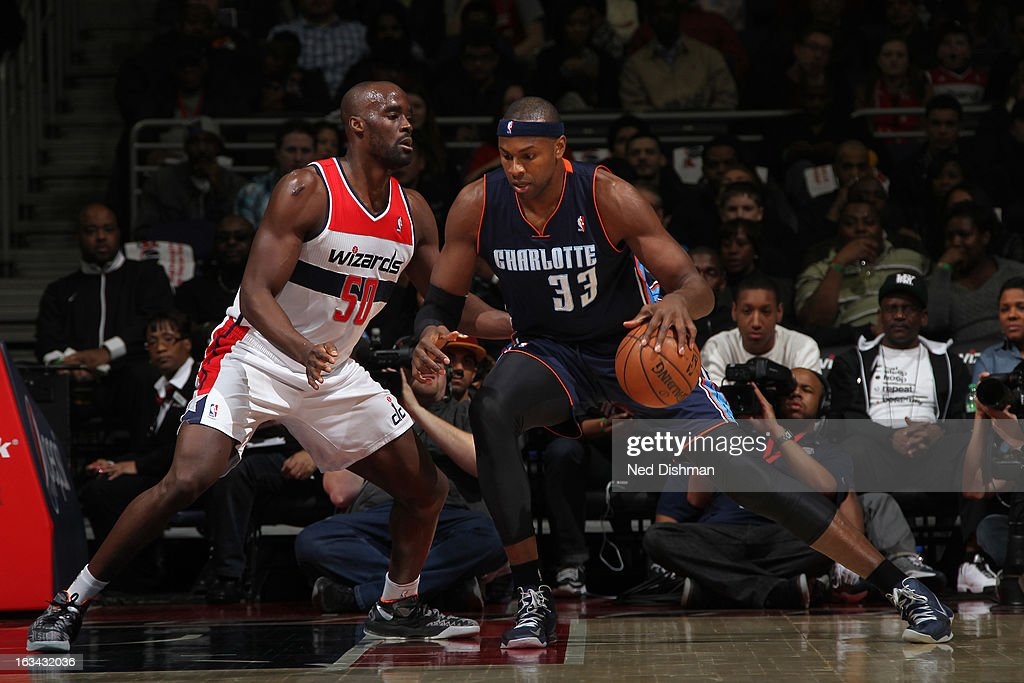 Brendan Haywood #33 of the Charlotte Bobcats drives against Emeka Okafor #50 of the Washington Wizards during the game at the Verizon Center on March 9, 2013 in Washington, DC.