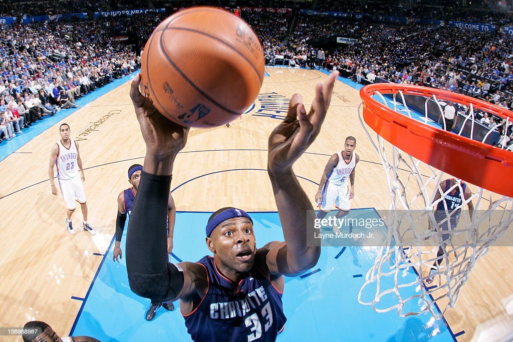 <a gi-track='captionPersonalityLinkClicked' href=/galleries/search?phrase=Brendan+Haywood&family=editorial&specificpeople=202010 ng-click='$event.stopPropagation()'>Brendan Haywood</a> #33 of the Charlotte Bobcats drives to the basket against the Oklahoma City Thunder on November 26, 2012 at the Chesapeake Energy Arena in Oklahoma City, Oklahoma.