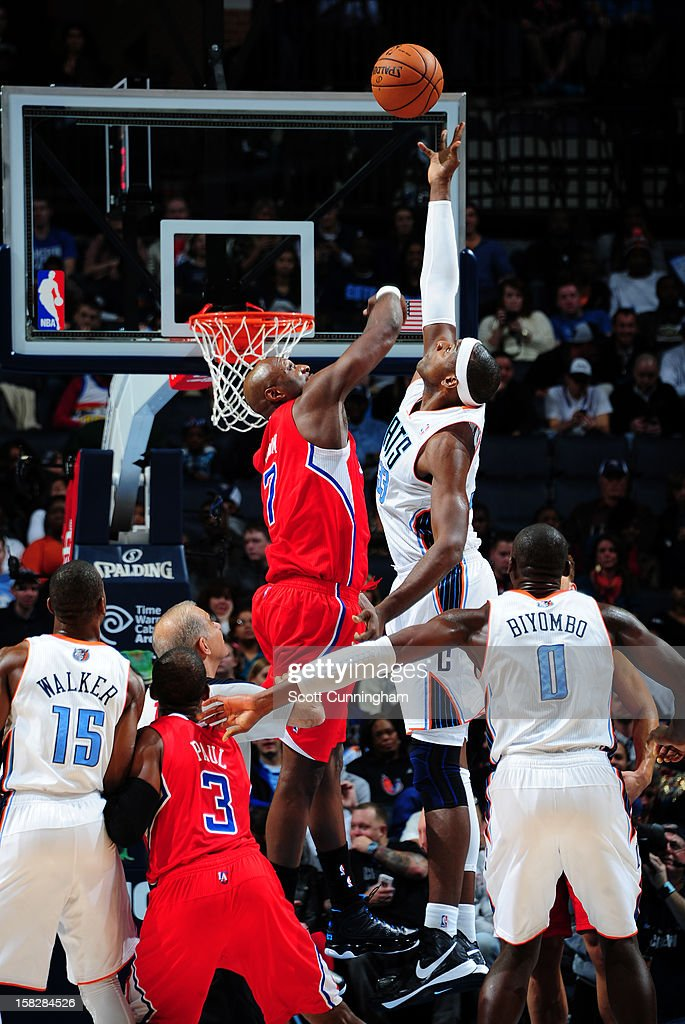 Brendan Haywood #33 of the Charlotte Bobcats goes up for a rebound against Lamar Odom #7 of the Los Angeles Clippers at Time Warner Cable Arena on December 12, 2012 in Charlotte, North Carolina.