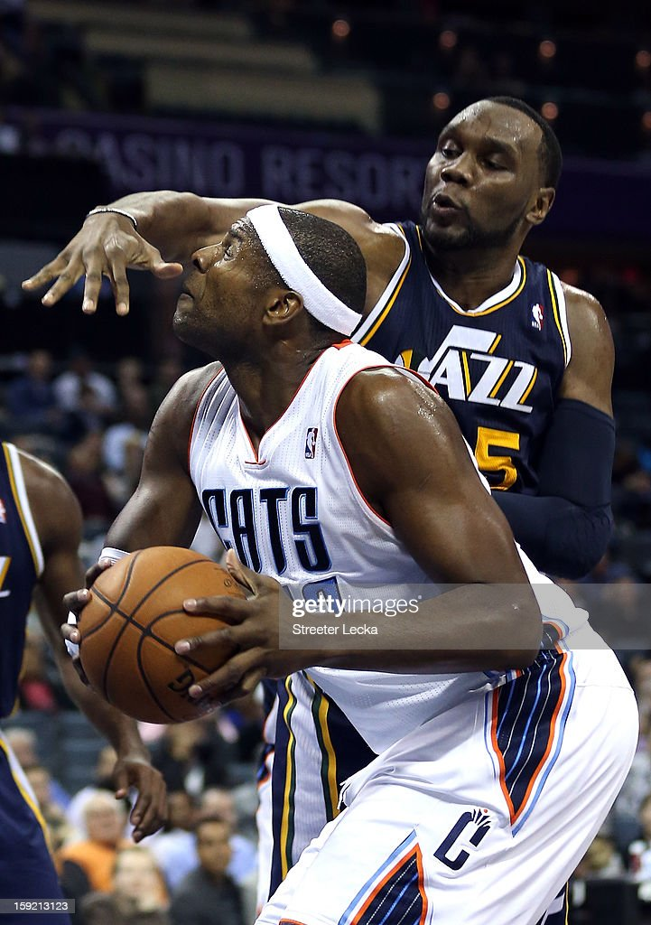 Brendan Haywood #33 of the Charlotte Bobcats is hit by Al Jefferson #25 of the Utah Jazz during their game at Time Warner Cable Arena on January 9, 2013 in Charlotte, North Carolina.