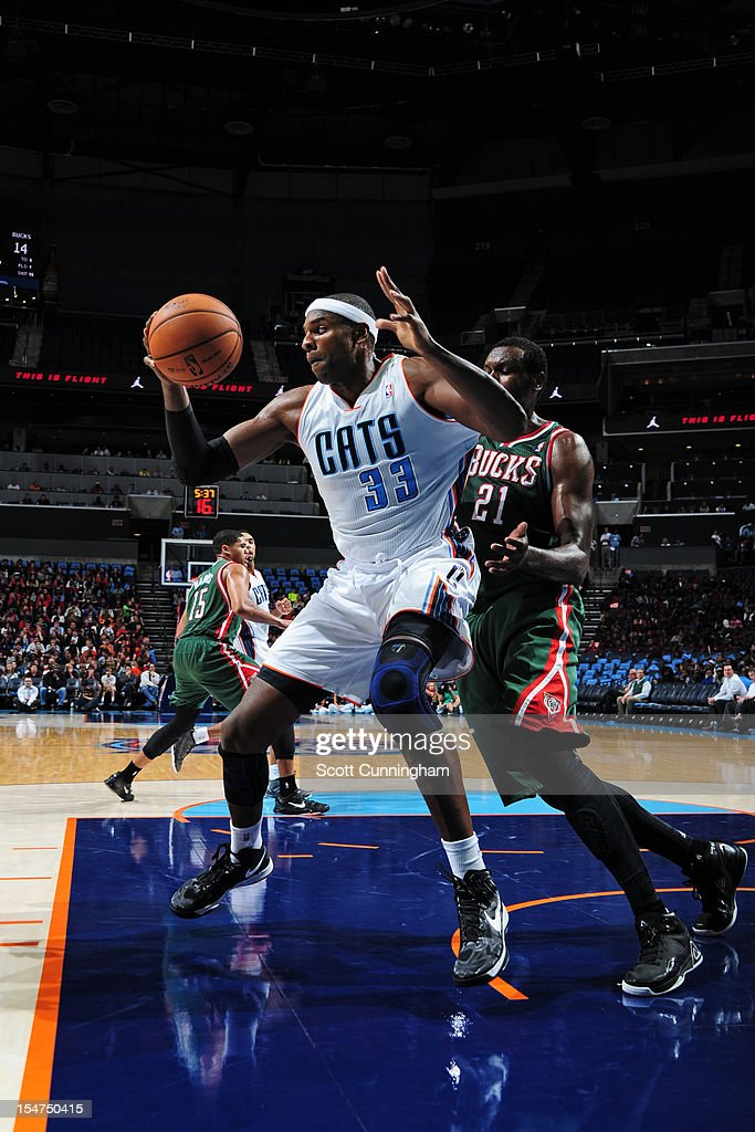 <a gi-track='captionPersonalityLinkClicked' href=/galleries/search?phrase=Brendan+Haywood&family=editorial&specificpeople=202010 ng-click='$event.stopPropagation()'>Brendan Haywood</a> #33 of the Charlotte Bobcats looks to make a post move against <a gi-track='captionPersonalityLinkClicked' href=/galleries/search?phrase=Samuel+Dalembert&family=editorial&specificpeople=202026 ng-click='$event.stopPropagation()'>Samuel Dalembert</a> #21 of the Milwaukee Bucks at the Time Warner Cable Arena on October 25, 2012 in Charlotte, North Carolina.