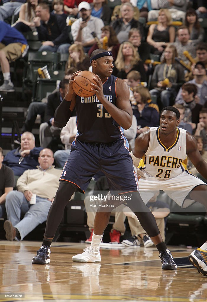 Brendan Haywood #33 of the Charlotte Bobcats protects the ball from Ian Mahinmi #28 of the Indiana Pacers during the game between the Indiana Pacers and the Charlotte Bobcats on January 12, 2013 at Bankers Life Fieldhouse in Indianapolis, Indiana.