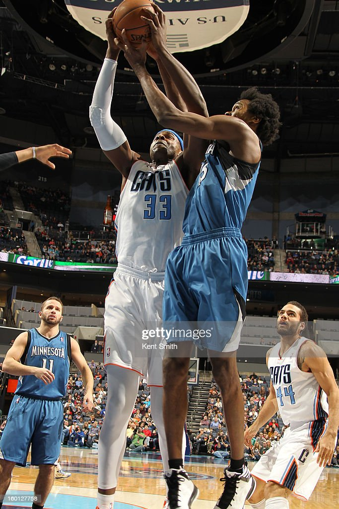 Brendan Haywood #33 of the Charlotte Bobcats shoots against Mickael Gelabale #15 of the Minnesota Timberwolves at the Time Warner Cable Arena on January 26, 2013 in Charlotte, North Carolina.