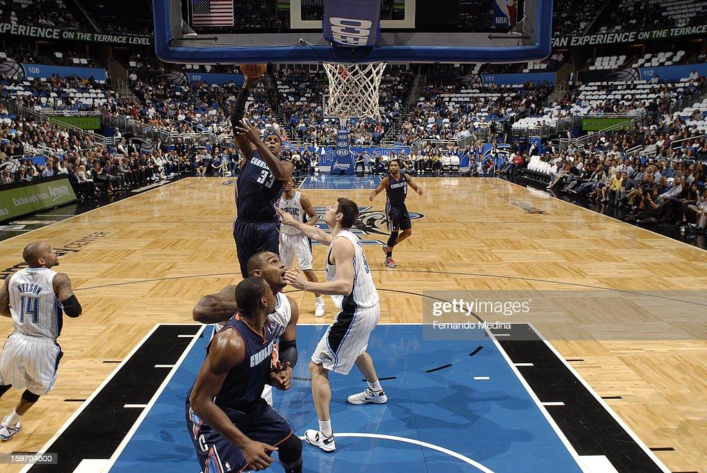 Brendan Haywood #33 of the Charlotte Bobcats shoots against Nikola Vucevic #9 of the Orlando Magic on January 18, 2013 at Amway Center in Orlando, Florida.