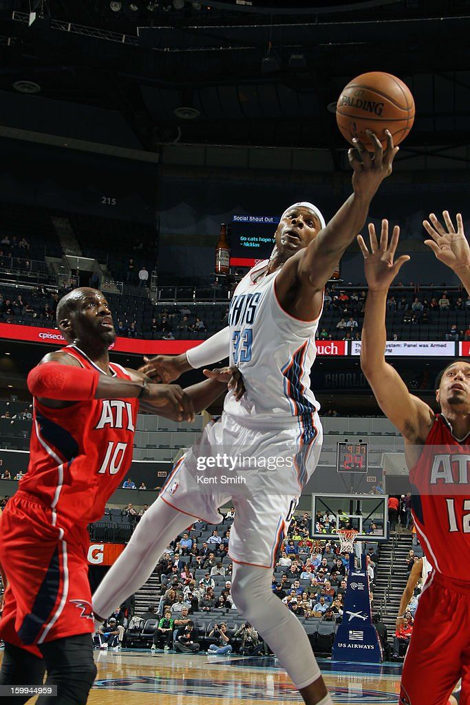 Brendan Haywood #33 of the Charlotte Bobcats shoots against the Atlanta Hawks at the Time Warner Cable Arena on January 23, 2013 in Charlotte, North Carolina.