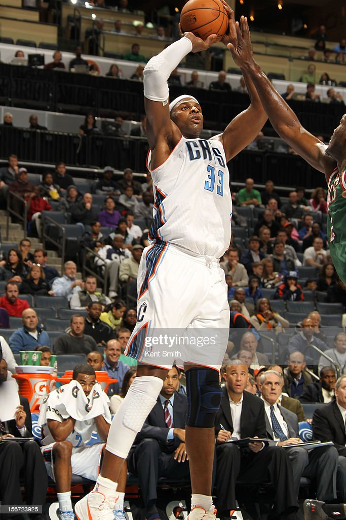 <a gi-track='captionPersonalityLinkClicked' href=/galleries/search?phrase=Brendan+Haywood&family=editorial&specificpeople=202010 ng-click='$event.stopPropagation()'>Brendan Haywood</a> #33 of the Charlotte Bobcats shoots against the Milwaukee Bucks at the Time Warner Cable Arena on November 19, 2012 in Charlotte, North Carolina.