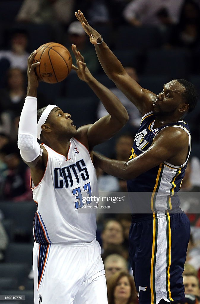 Brendan Haywood #33 of the Charlotte Bobcats tries to shoot over Al Jefferson #25 of the Utah Jazz during their game at Time Warner Cable Arena on January 9, 2013 in Charlotte, North Carolina.