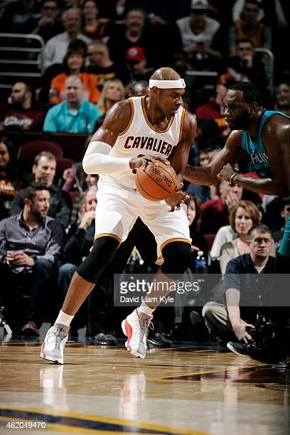 Brendan Haywood of the Cleveland Cavaliers handles the ball against the Charlotte Hornets at The Quicken Loans Arena on January 23 2015 in Cleveland...