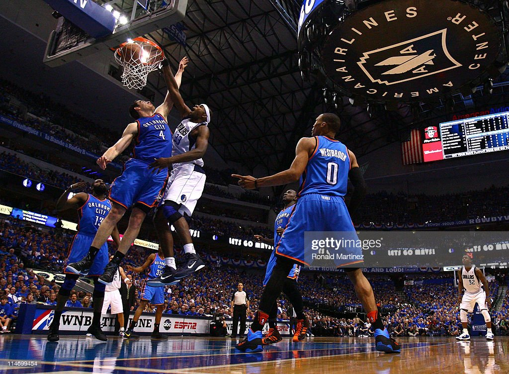 <a gi-track='captionPersonalityLinkClicked' href=/galleries/search?phrase=Brendan+Haywood&family=editorial&specificpeople=202010 ng-click='$event.stopPropagation()'>Brendan Haywood</a> #33 of the Dallas Mavericks dunks the ball over <a gi-track='captionPersonalityLinkClicked' href=/galleries/search?phrase=Nick+Collison&family=editorial&specificpeople=202843 ng-click='$event.stopPropagation()'>Nick Collison</a> #4 of the Oklahoma City Thunder in the second quarter in Game Five of the Western Conference Finals during the 2011 NBA Playoffs at American Airlines Center on May 25, 2011 in Dallas, Texas.