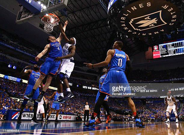 Brendan Haywood of the Dallas Mavericks dunks the ball over Nick Collison of the Oklahoma City Thunder in the second quarter in Game Five of the...