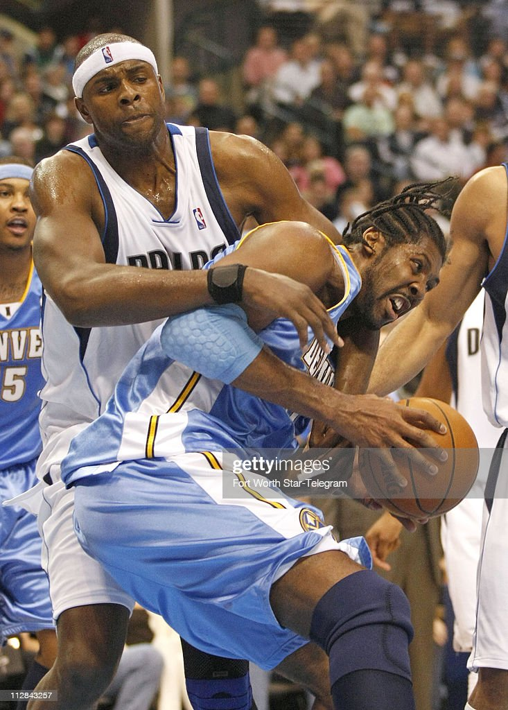 Brendan Haywood of the Dallas Mavericks guards Nene of the Denver Nuggets at the American Airlines Center in Dallas, Texas, Monday, March 29, 2010.