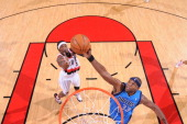 Brendan Haywood of the Dallas Mavericks shoots against Gerald Wallace of the Portland Trail Blazers in Game Four of the Western Conference...