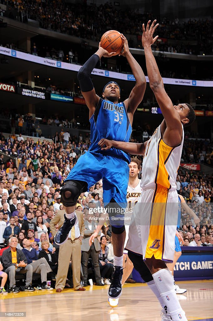 <a gi-track='captionPersonalityLinkClicked' href=/galleries/search?phrase=Brendan+Haywood&family=editorial&specificpeople=202010 ng-click='$event.stopPropagation()'>Brendan Haywood</a> #33 of the Dallas Mavericks shoots the ball against the Los Angeles Lakers on April 15, 2012 in Los Angeles, California.
