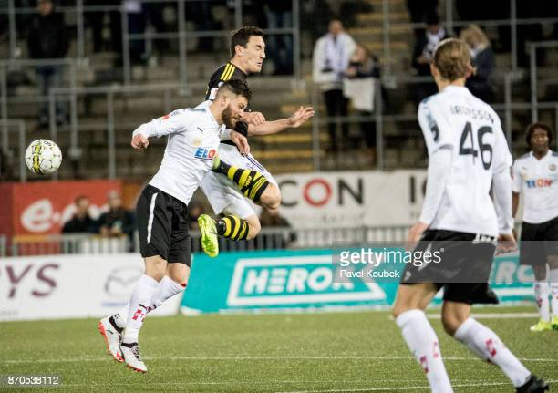 Brendan HinesIke of Orebro SK Stefan Ishizaki of AIK during the Allsvenskan match between Orebro SK AIK at Behrn Arena on November 5 2017 in Orebro...