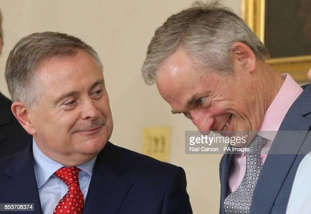 Brendan Howlin and Richard Bruton watch as their colleagues recieve their Ministerial Seals of Office at Aras an Uachtarain Dublin after today's...