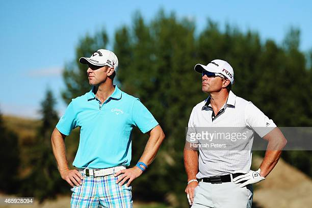 Brendan Jones of Australia and former All Blacks rugby player Justin Marshall look on during day one of the New Zealand Open at Millbrook Resort on...