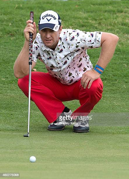 Brendan Jones of Australia lines up a putt on the sixth hole during day one of the 2014 Australian PGA Championship at Royal Pines Resort on December...