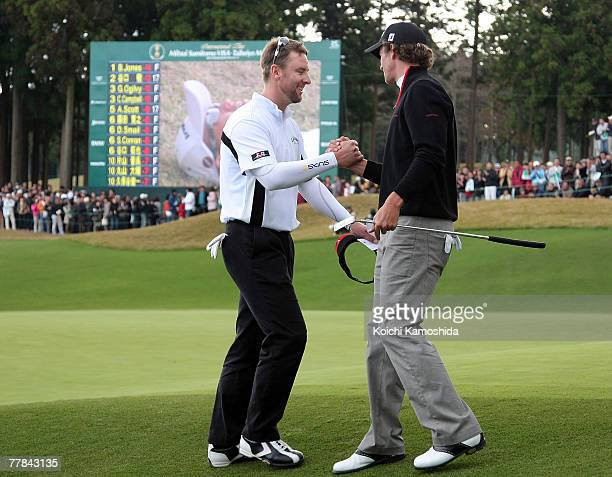 Brendan Jones of Australia shakes hands with Adam Scott of Australia on the 18th green after the final round of the Sumitomo Visa Taiheiyo Masters...