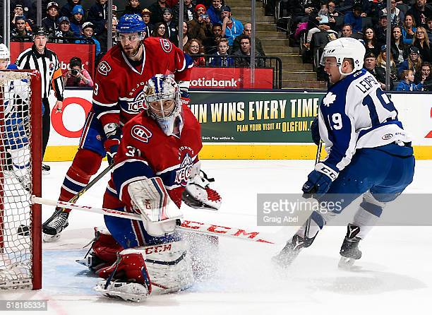 Brendan Leipsic of the Toronto Marlies puts on by Zachary Fucale Josiah Didier of the St John's IceCaps during game action on March 26 2016 at Air...