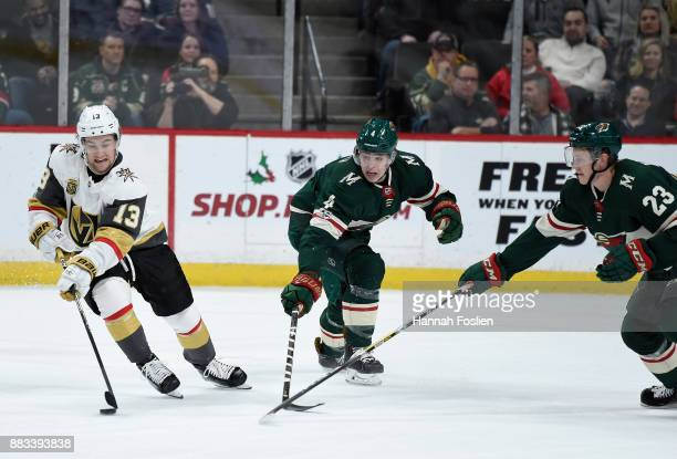 Brendan Leipsic of the Vegas Golden Knights controls the puck against Mike Reilly and Gustav Olofsson of the Minnesota Wild during the second period...