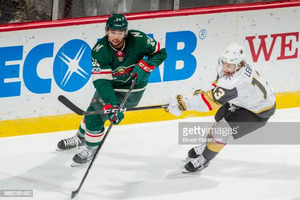 Brendan Leipsic of the Vegas Golden Knights defends Matt Dumba of the Minnesota Wild during the game at the Xcel Energy Center on November 30 2017 in...