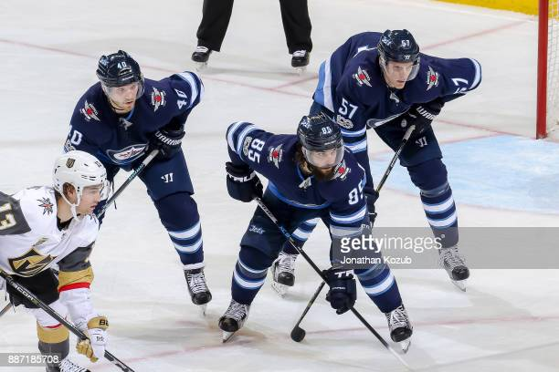 Brendan Leipsic of the Vegas Golden Knights lines up against Joel Armia Mathieu Perreault and Tyler Myers of the Winnipeg Jets during a third period...