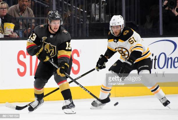 Brendan Leipsic of the Vegas Golden Knights passes the puck under pressure from Ryan Spooner of the Boston Bruins in the first period of their game...