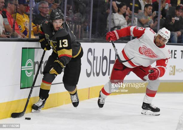 Brendan Leipsic of the Vegas Golden Knights skates with the puck behind the net against Trevor Daley of the Detroit Red Wings during their game at...