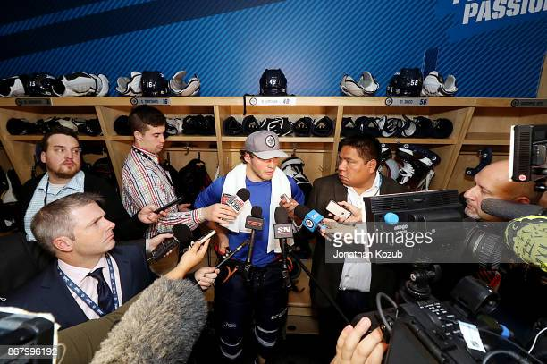 Brendan Lemieux of the Winnipeg Jets faces a throng of media following a 71 victory over the Pittsburgh Penguins at the Bell MTS Place on October 29...