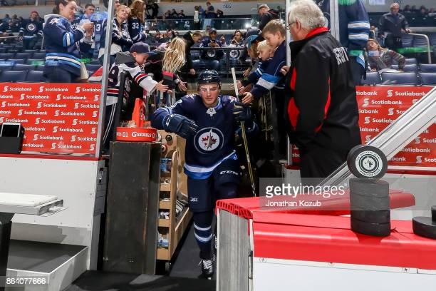 Brendan Lemieux of the Winnipeg Jets heads to the ice for the start of the pregame warm up prior to NHL action against the Minnesota Wild at the Bell...