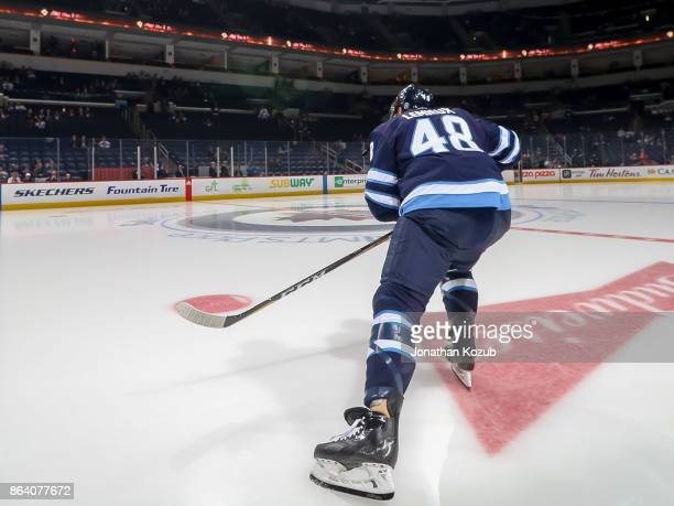 Brendan Lemieux of the Winnipeg Jets hits the ice for a solo lap during the pregame warm up prior to NHL action against the Minnesota Wild at the...
