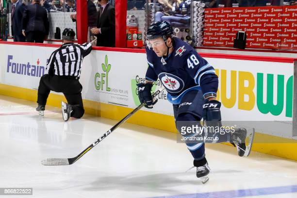 Brendan Lemieux of the Winnipeg Jets hits the ice prior to puck drop against the Minnesota Wild at the Bell MTS Place on October 20 2017 in Winnipeg...